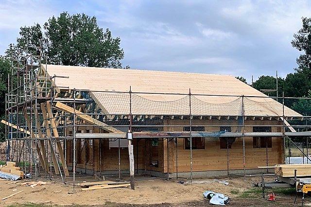 Holzbau Brandt baut in Mecklenburg - Blockhaus - Aufdachdämmung